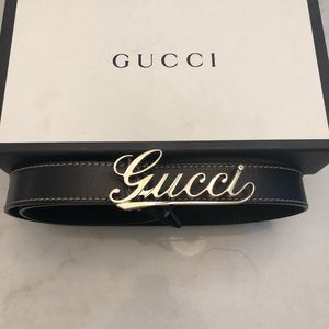 Gucci: men's very rare Gucci cursive belt.  Silver